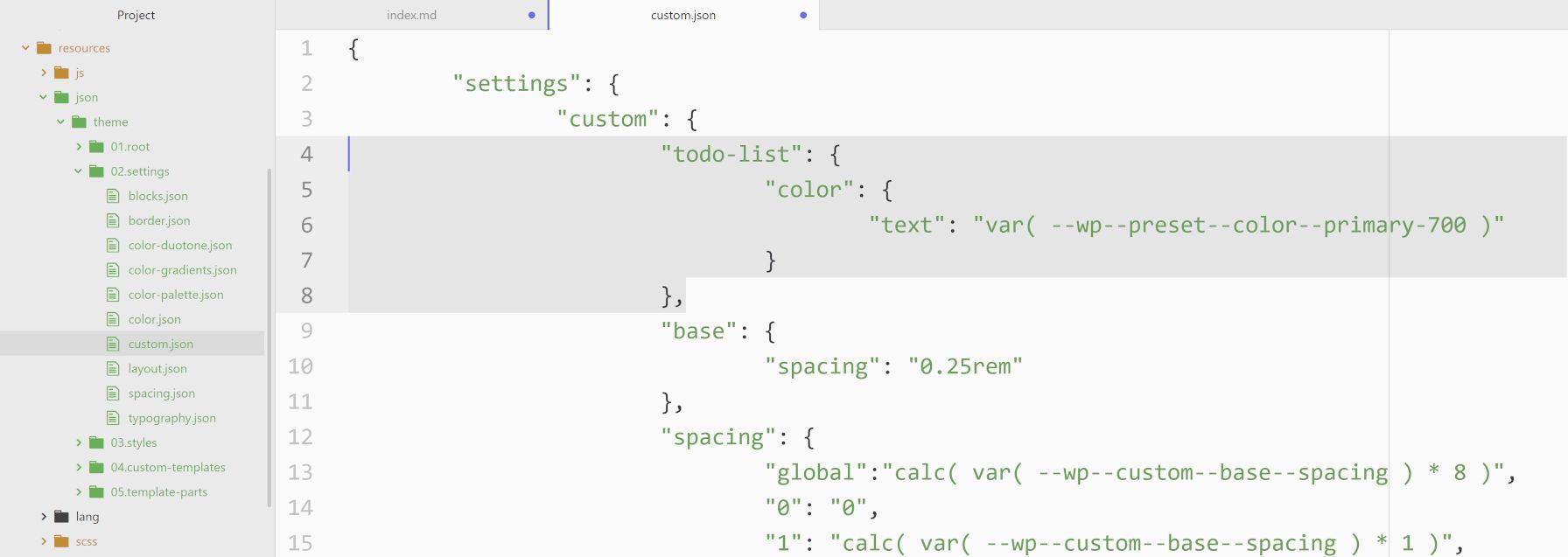 Capture d'écran d'un éditeur de code avec le code theme.json à intégrer au plugin de bloc Todo List.